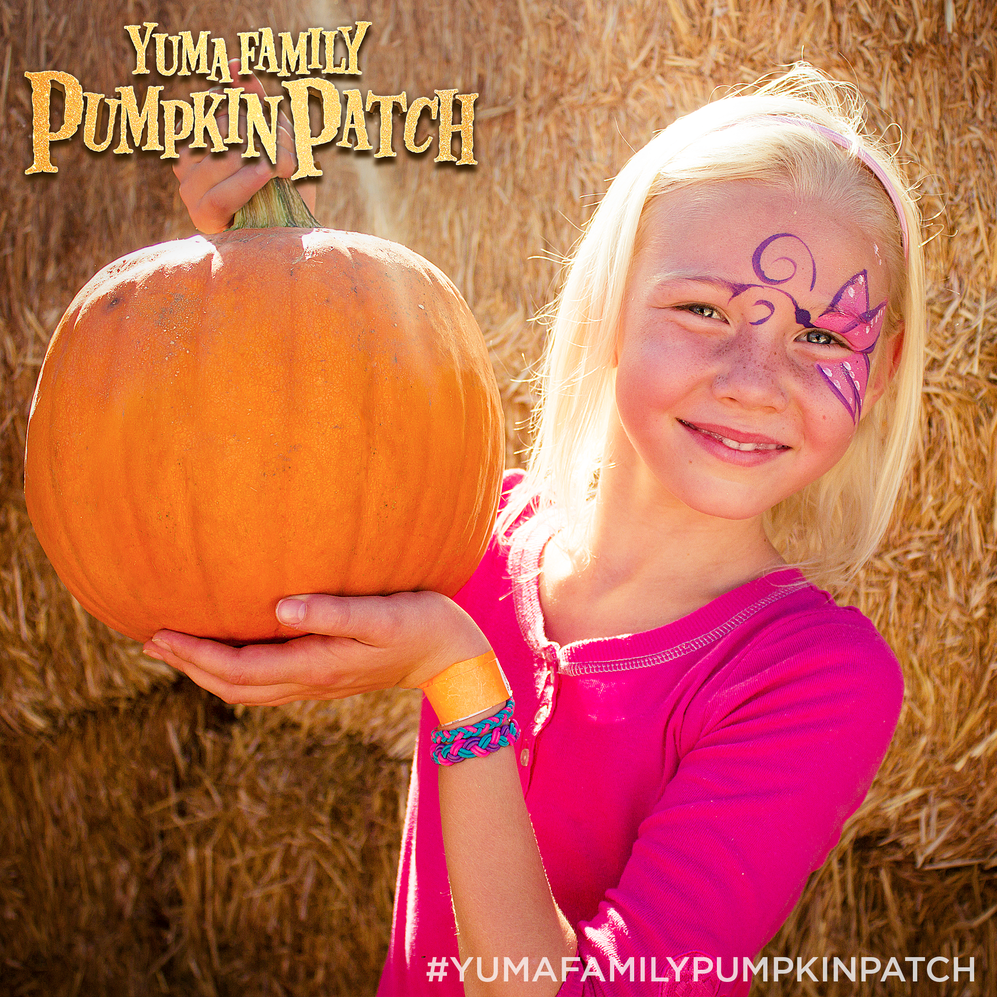 This is a photo of a smiling little girl wearing a bright pink shirt who was at the Yuma Family Pumpkin Patch which is hosted at Champion Church!